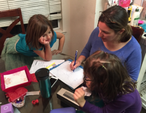 Sabrina drawing a family tree for the girls