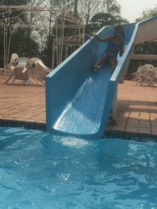 Hannah successfully overcomes her fear of the big water slide!