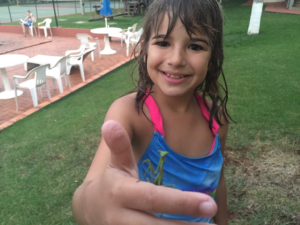 Hannah with a praying mantis. She also had lots of butterflies land on her in Brazil!