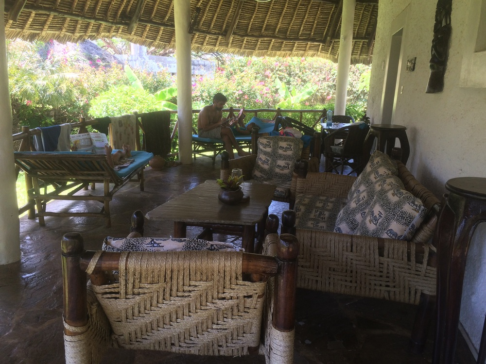 Outdoor living/dining area with 2 loungers, the girls enjoyed.