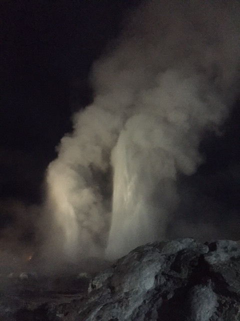 Geysers by night. Just before we left, the tour guides sang a song & that is when the Geyser started to erupt!