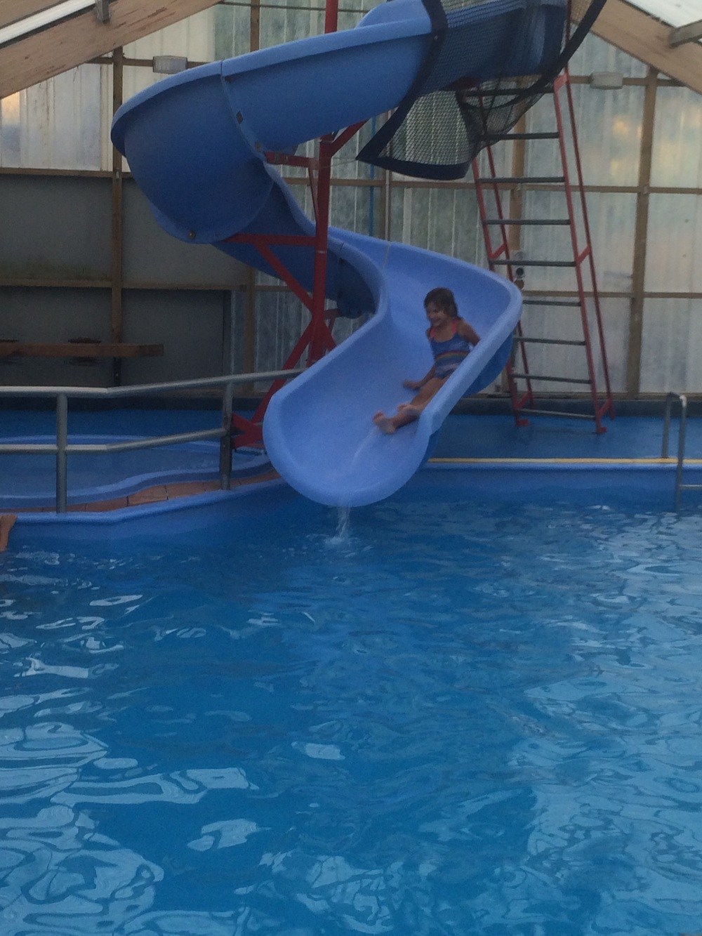 Hannah coming down the water slide.
