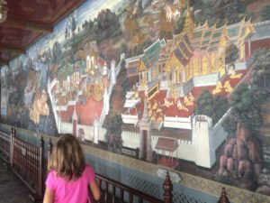 Checking out the murals in The Grand Palace Complex. For some reason, outside the Palace, Thai men tell unsuspecting tourists that the Palace is closed. The Palace has announcements over loud speakers saying it's not true.