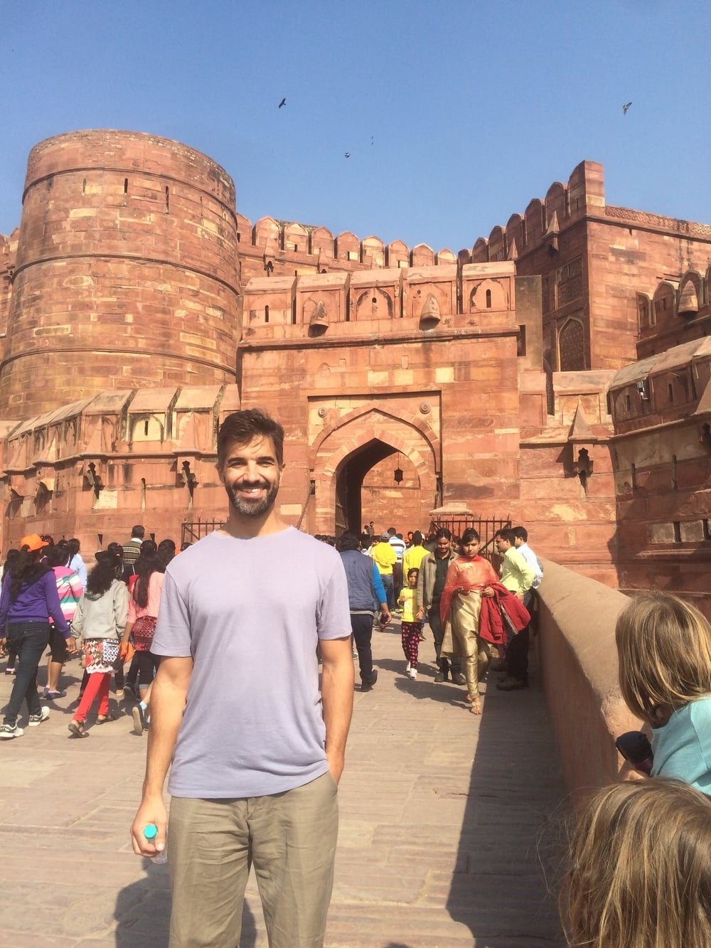 Anthony outside the Agra Fort. With a moat, a drawbridge, and narrow openings in which the guards could shoot arrows, the Fort was impenetrable, until the British came along with its guns and cannons!