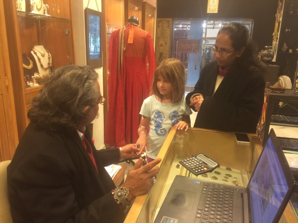 The shop owner admiring the ring that Hannah chose. Druzy (druse) are tiny crystals on a base mineral. It was cut, polished and assembled in India.