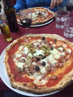 Neapolitan pizza, much different from Parma food. Pizza wasn't as big in Parma