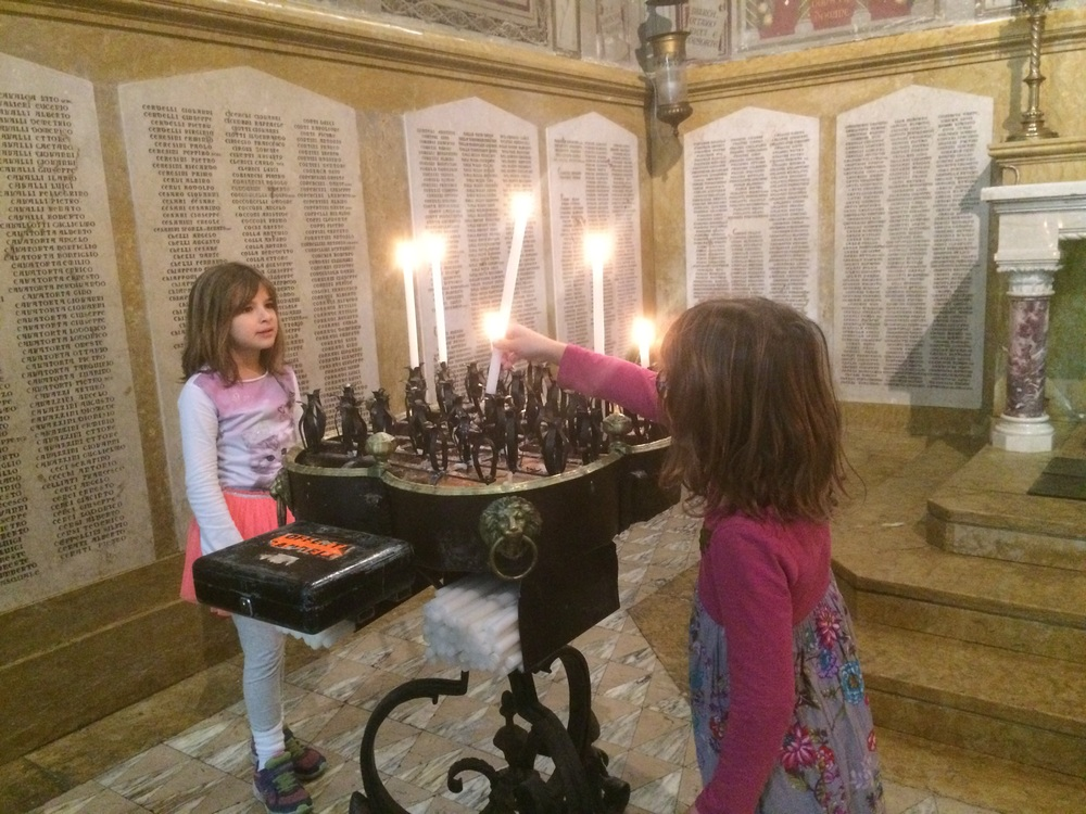 Lighting candles of remembrance in the historic Cathedral