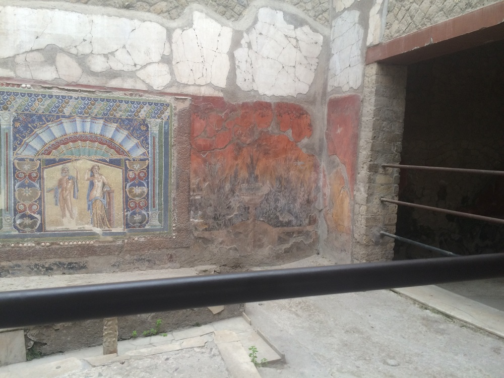A well preserved mosaic and wall painting. Many mosaics from Herculaneum and Pompeii are on display at the Naples Archaeological Museum