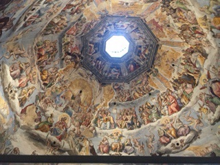Inside the Duomo. It's the largest brick dome in the world and a World Heritage site. The portrayal of Hell is quite graphic and violent.
