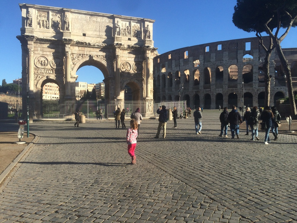 Amy walking towards the Constantine Arch and Colosseum