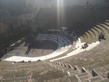 The theatre. Some of the marble seats are still there.