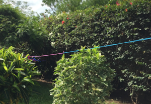 Our laundry line with a couple foldable hangers at our beach house in Galu Kinondo, Kenya