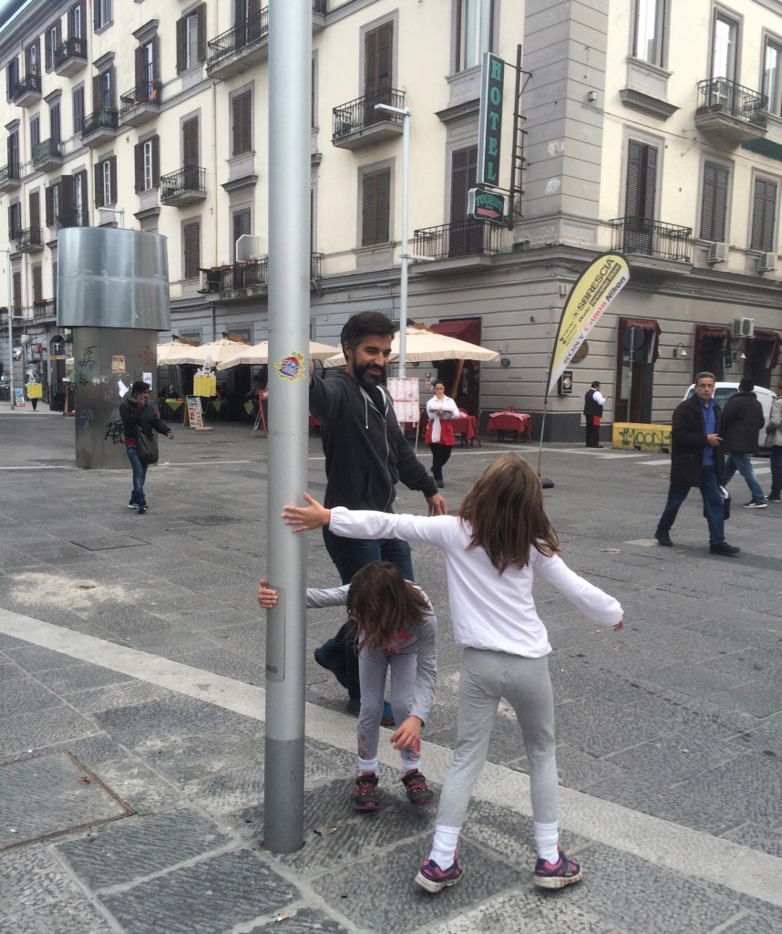 Taking a break by making up a game with a lamp post in Naples