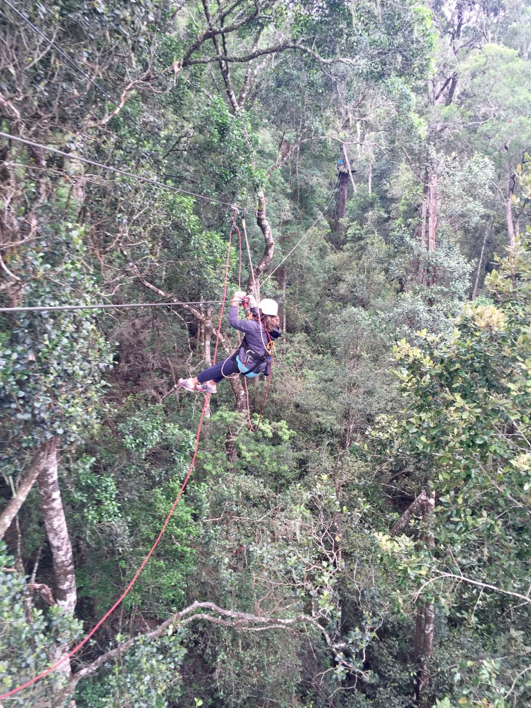 Sabrina zip lining through the trees at Tsitsikamma National Park