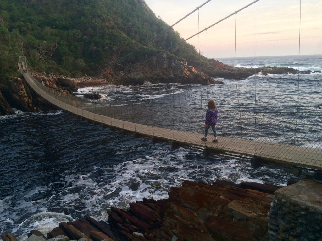 Amy crossing the mouth of Storms River at sunset