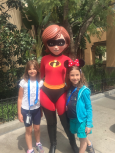 Hannah and Amy with Elastigirl; just one of the many characters the girls met at Disneyland and Disney California Adventure