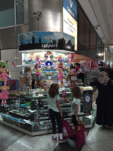 Passing the time by checking out the trinkets at the Ataturk Airport in Turkey