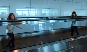 Having fun on the moving sidewalk. Ataturk Airport, Istanbul, Turkey