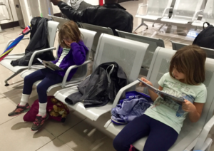 Reading at the airport in Rome, Italy