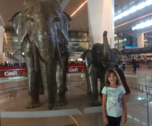 Checking out airport art is also a great thing to do. Hannah loved the elephant statues at the Indira Gandhi Airport, New Delhi, India