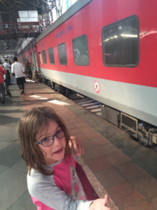 Amy at the train station in Mumbai