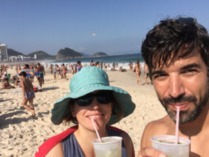 Enjoying drinks from a beach vendor in Rio de Janeiro, Brazil