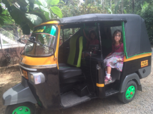 Amy (and Hannah) in the auto rickshaw in Kumily
