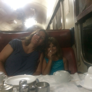 It was hot in the dining car. Hannah liked the sugar cubes!