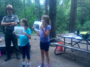Playing a game at the Junior Ranger campfire.