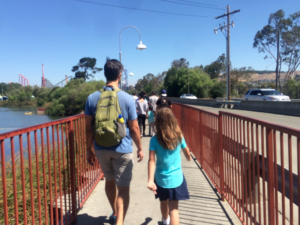 My husband and daughter walking over the bridge from the parking lot to the entrance.