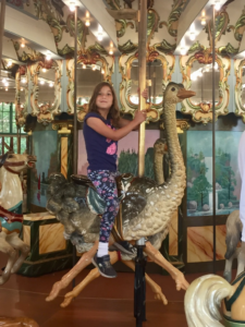 Amy on the Dentzel Carousel