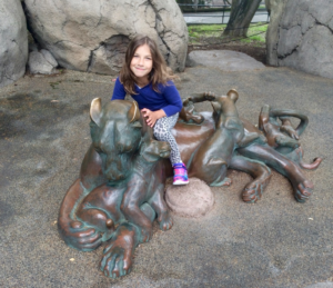 Amy loved getting her picture taken with all the statues!