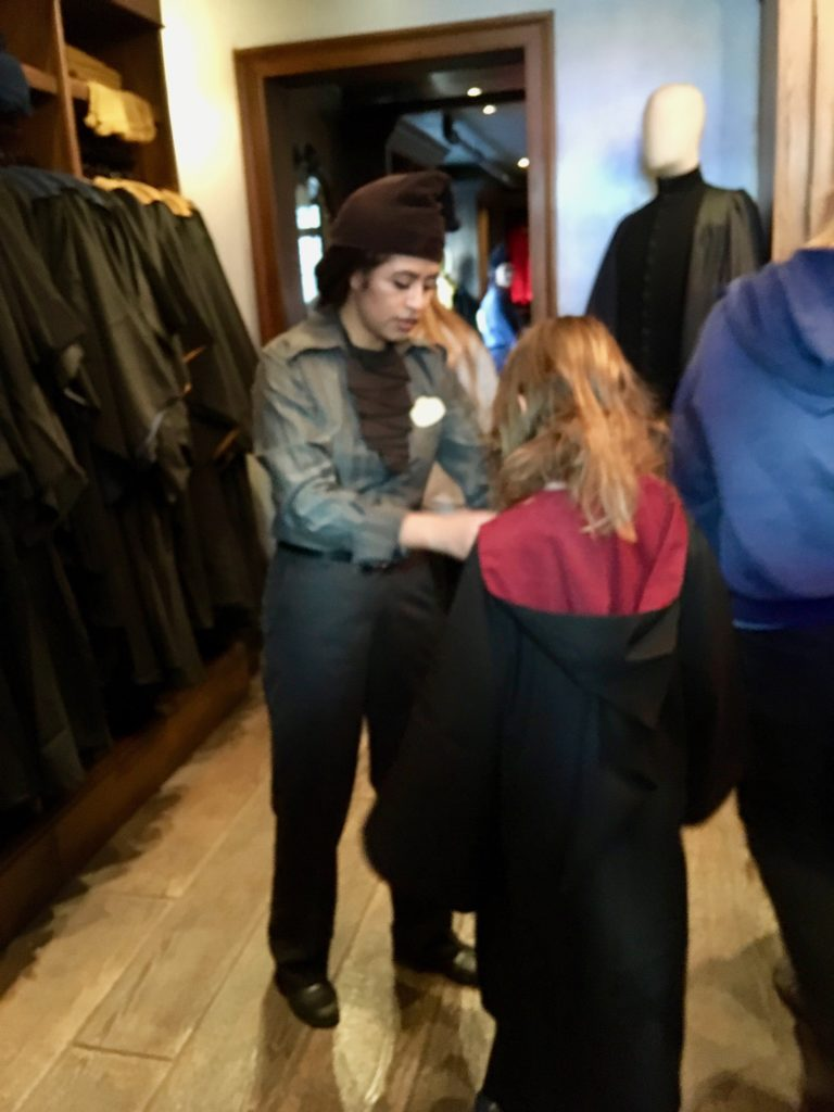 Amy being fitted for her Gryffindor robes