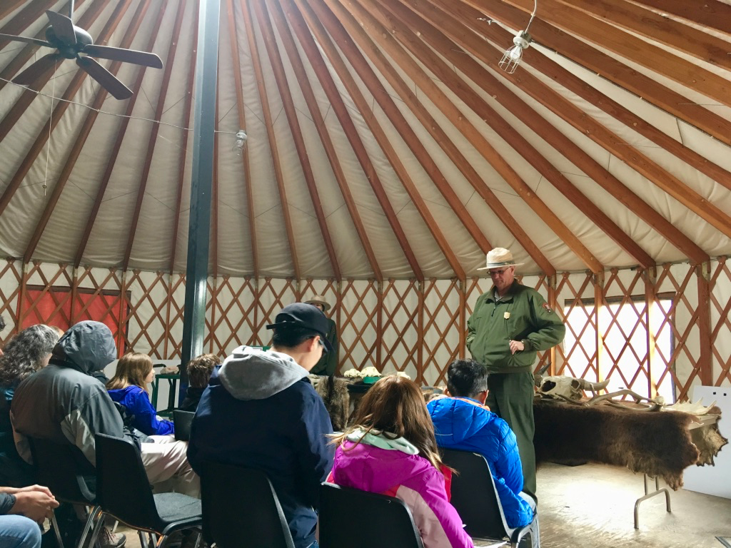 Staying dry listening to the Ranger talk in the yurt.