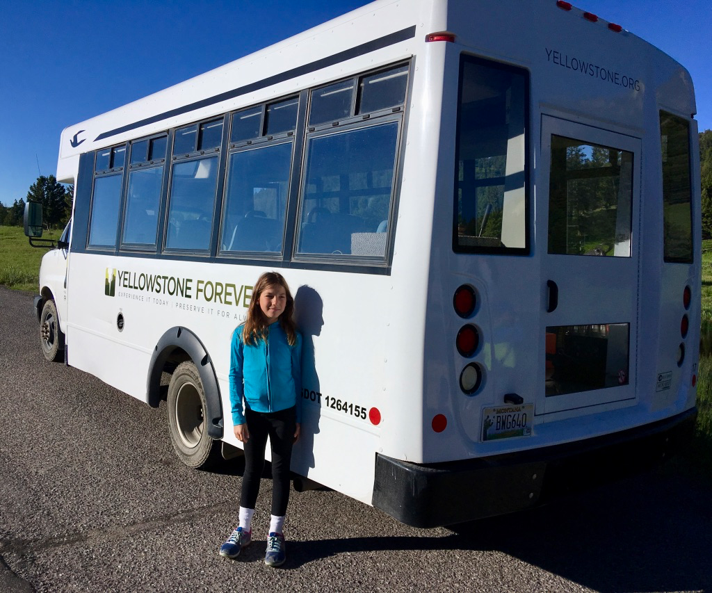 Amy beside the Yellowstone Forever bus we took.